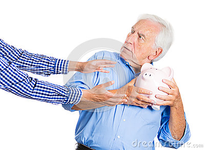 Elderly, senior man, grandfather, holding a piggy bank, looking scared, trying to protect his savings from being stolen