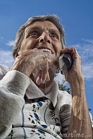 Elderly Senior Woman Using Cordless Phone