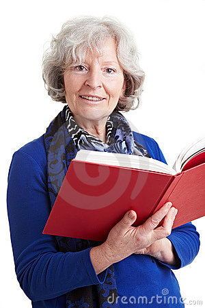 Elderly teacher reading a book