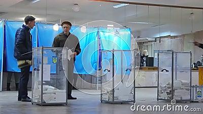 Elderly voter near ballot box at vote station. Election. Ukraine. DNIPRO, UKRAINE - March 31, 2019: Elderly voter near ballot box at vote station. Election of