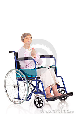 Elderly wheelchair praying