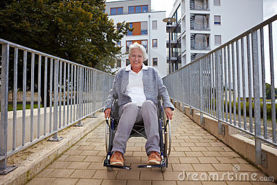 Elderly wheelchair user on ramp