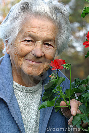 Free Elderly Woman And Flowers Stock Images - 555234