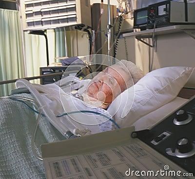 Elderly woman asleep in hospital bed