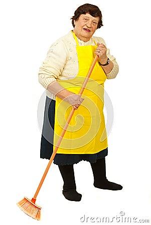 Elderly woman with broom