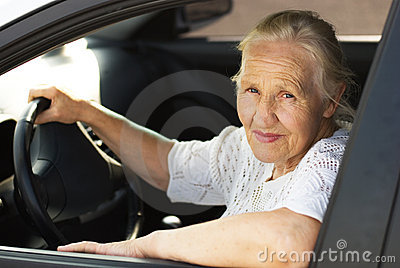 Elderly woman in the car