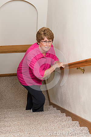 Free Elderly Woman Climb Stairs Mobility Issues Royalty Free Stock Photo - 64271595