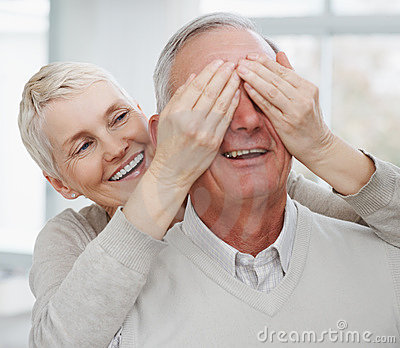 Elderly Woman Covering Husband's Eyes Stock Image - Image: 11827601