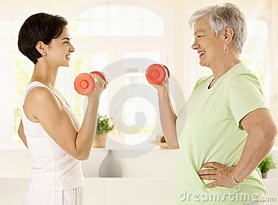 Elderly woman doing dumbbell exercise