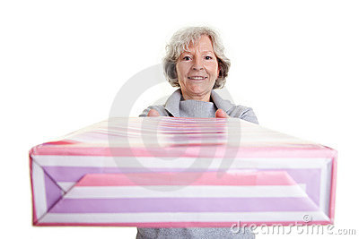 Elderly woman donating big gift