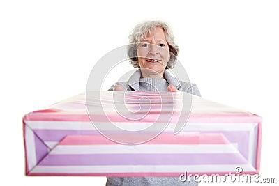 Elderly woman donating big gift