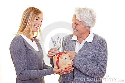 Elderly woman donating money