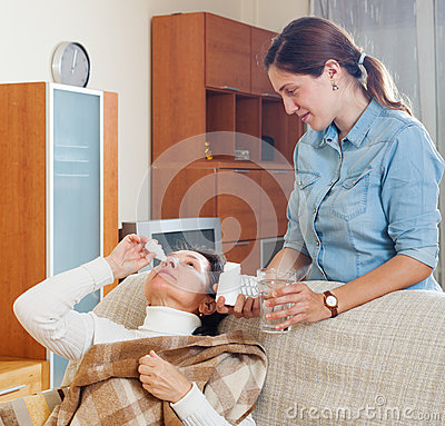Elderly woman dripping nose drops