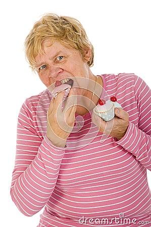 Elderly woman is eating