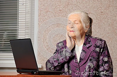 The elderly woman in front of the laptop