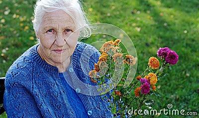 Elderly woman on green meadow