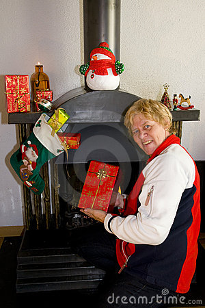 Elderly woman happy with presents
