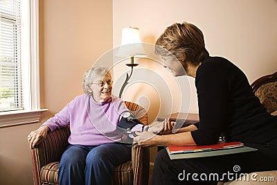 Elderly Woman Having Blood Pressure Taken