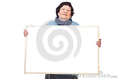 Elderly woman holding banner