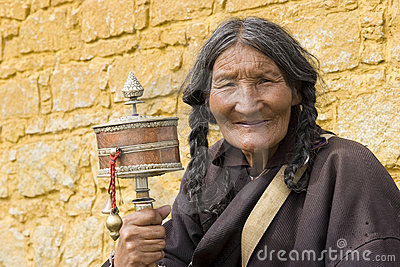 Elderly woman holding prayer wheel Editorial Image