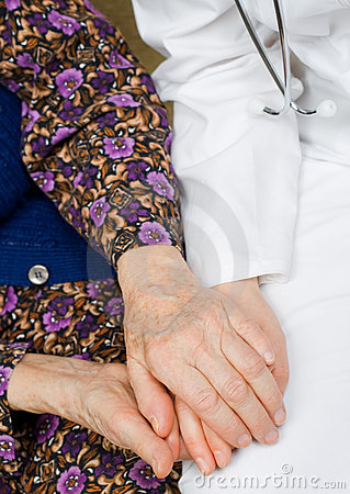 Elderly woman holds the doctor s hands