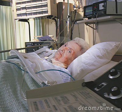 Elderly woman in hospital bed