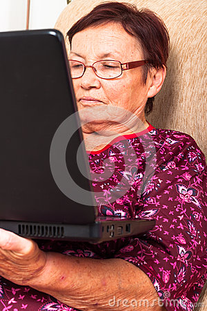 Elderly woman with laptop