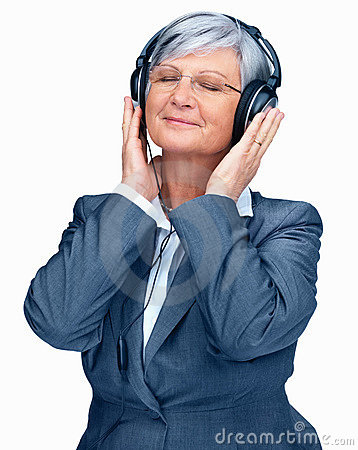 Elderly woman listening to music over headphones