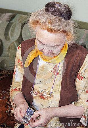 Elderly woman with a mobile