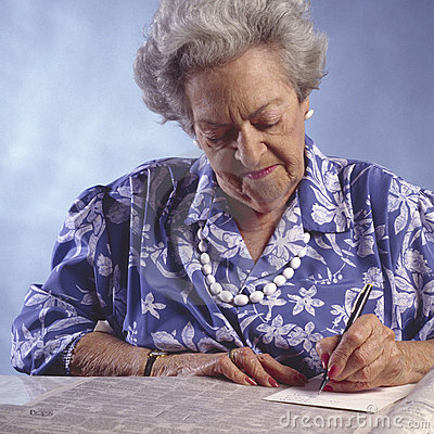 Elderly woman with newspaper classified section#2