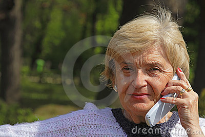 Elderly woman with phone