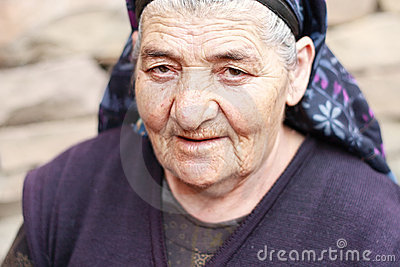 Elderly woman with piercing gaze