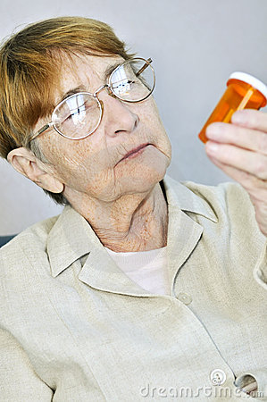 Elderly woman with pill bottle