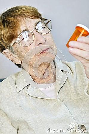 Elderly woman with pill bottle