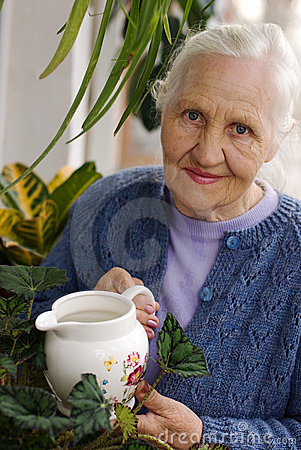 Elderly woman with plants