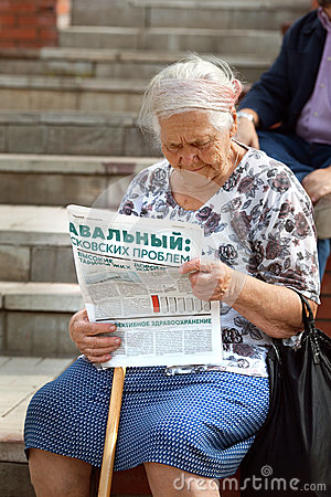 The elderly woman reads the newspaper in support of Alexei Navalny Editorial Stock Photo