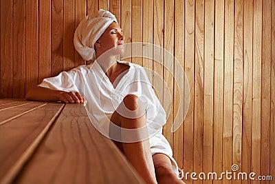 Elderly woman relaxing in sauna