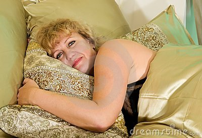 Elderly woman rests in bed