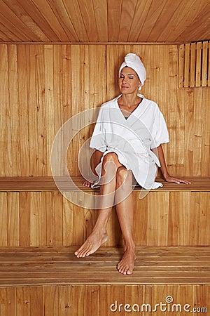 Elderly woman in sauna