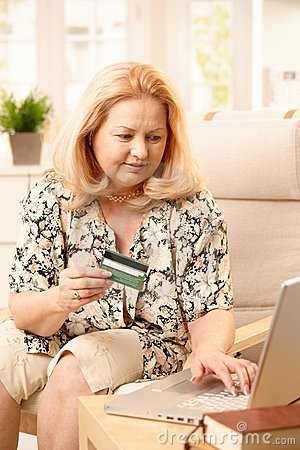 Elderly woman shopping on internet