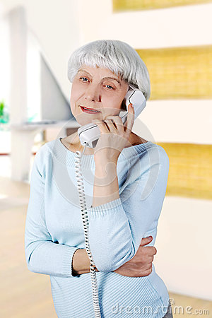 Free Elderly Woman Speaks On The Phone Royalty Free Stock Photography - 39844757