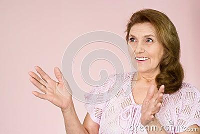 Elderly woman stands