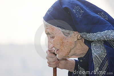 Elderly woman with stick