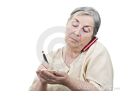 Elderly woman taking notes at cellphone