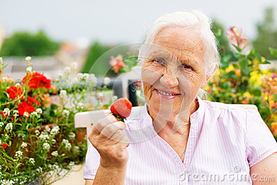 Elderly woman on the terrace