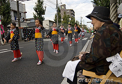 Elderly woman watching Japanese Festival Dancers Editorial Image
