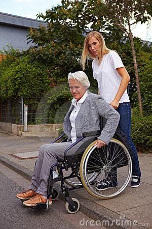 Elderly woman with wheelchair