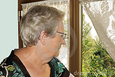 Elderly woman at window