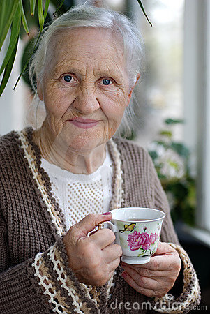 Free Elderly Woman With Cup Of Tea Royalty Free Stock Photos - 14953618