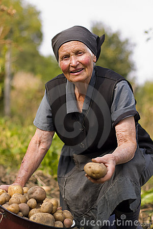 Elderly woman working outdoors